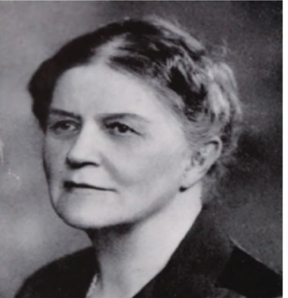 A black and white photograph of Ida Smedley Maclean looking to the side of the camera.