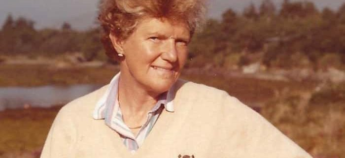 A colour photograph of Lady Joan Reid. A lady looking towards the camera wearing a cream jumper.